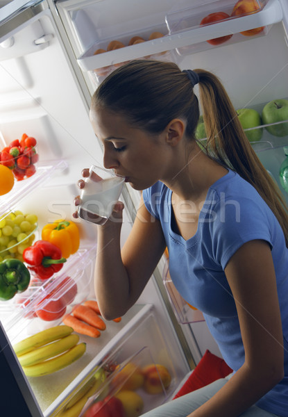 Stock photo: Woman drinking milk