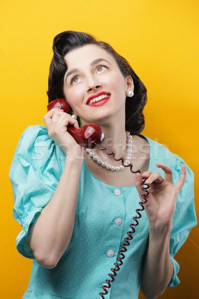 Vintage calling woman Stock photo © stokkete