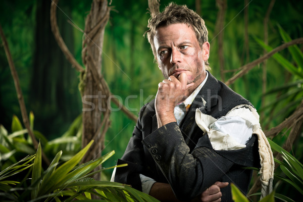 Pensive businessman in the jungle planning strategies. Stock photo © stokkete