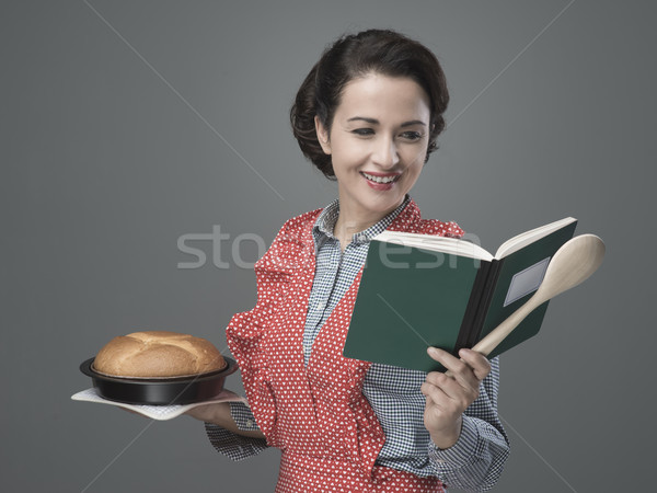 Retro housewife with cookbook Stock photo © stokkete