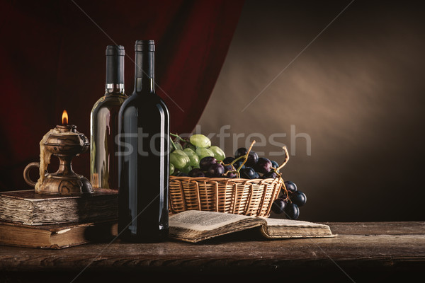 Wine still life with old books Stock photo © stokkete