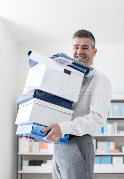 Happy office worker carrying boxes Stock photo © stokkete