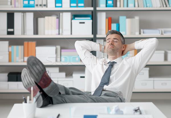 Geschäftsmann schlafen Büro faul Fuß up Stock foto © stokkete