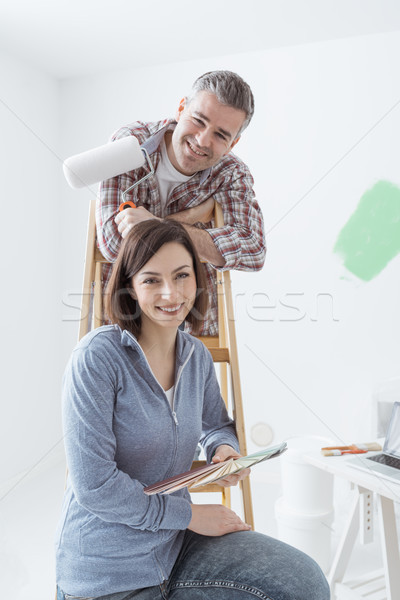 Couple painting their house Stock photo © stokkete