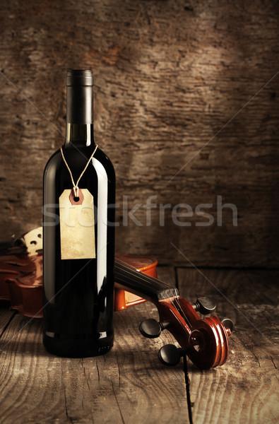 Vino rosso bottiglia violino legno bere antichi Foto d'archivio © stokkete
