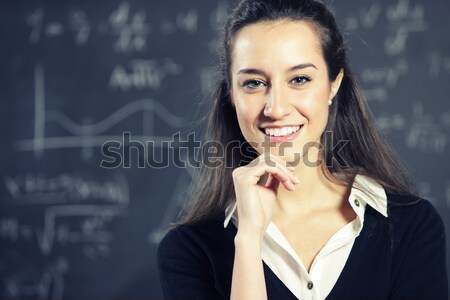Portrait of a young woman, college student or teacher in front o Stock photo © stokkete