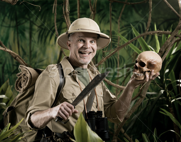 Explorer with human skull Stock photo © stokkete