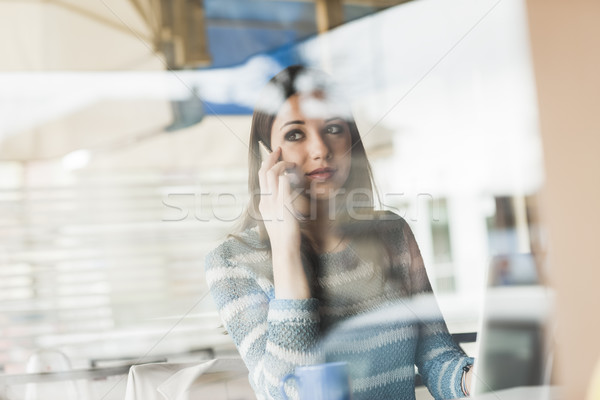 Young woman having a phone call Stock photo © stokkete