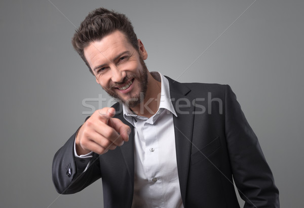 Happy businessman laughing and pointing finger Stock photo © stokkete