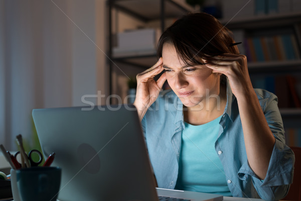 Woman having an headache late at night Stock photo © stokkete