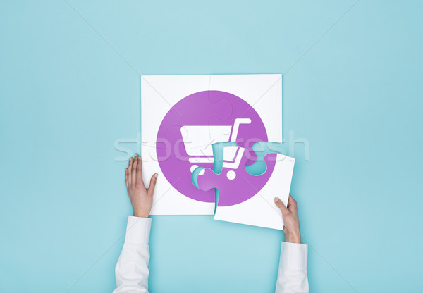 Woman completing a puzzle with a shopping cart icon Stock photo © stokkete