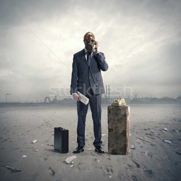 üzletember telefon telefon öltöny portré maszk Stock fotó © stokkete