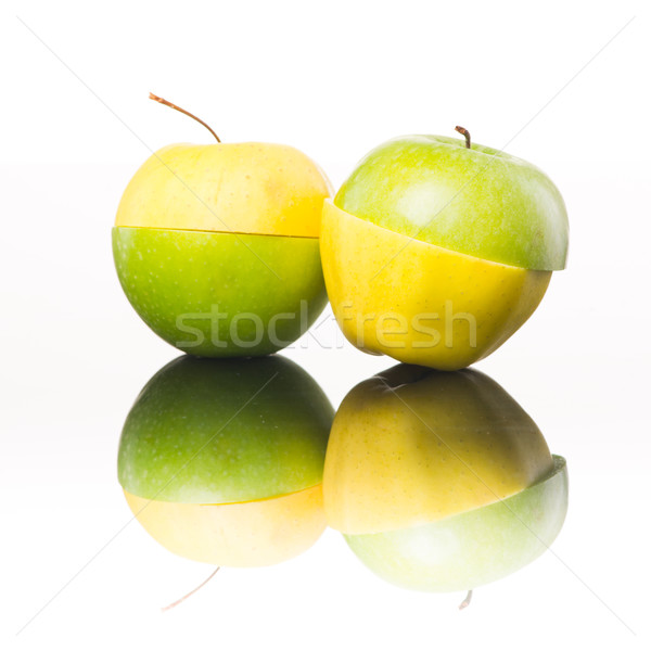 Juicy yellow and green apples sliced Stock photo © stokkete