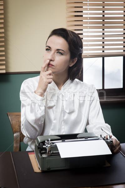Pensive secretary with typewriter Stock photo © stokkete