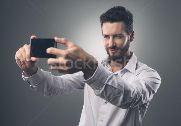 Serin adam yakışıklı adam portreler Stok fotoğraf © stokkete