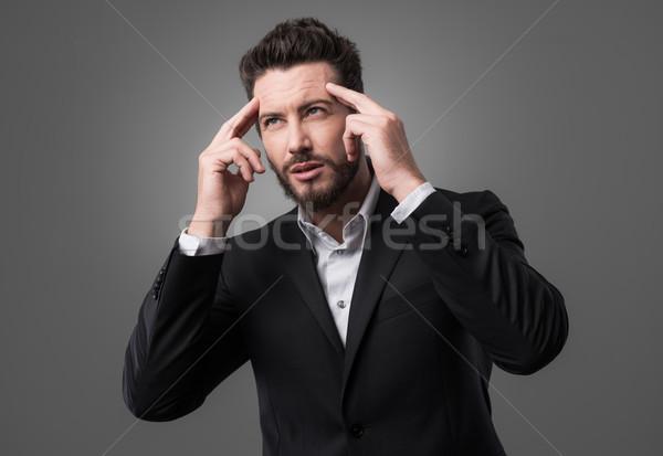 Fiatal üzletember másfelé néz megérint üzletember öltöny Stock fotó © stokkete
