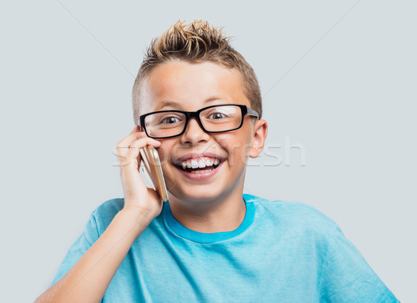 Smiling boy having a phone call Stock photo © stokkete