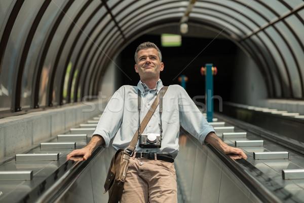 Confident businessman on the escalator Stock photo © stokkete