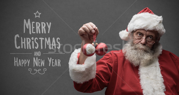 Lazy Santa Claus holding Christmas balls Stock photo © stokkete