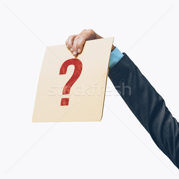 Businessman holding a file with a question mark Stock photo © stokkete