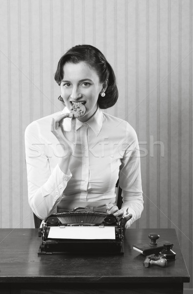 Business woman eating a cookie Stock photo © stokkete