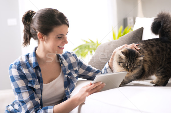 Woman and cat in the living room Stock photo © stokkete