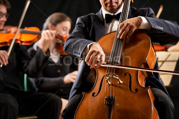 Symphony orchestra performance: celloist close-up Stock photo © stokkete