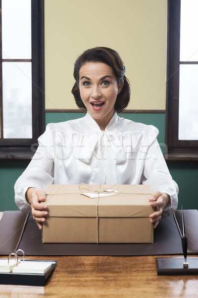 Secretary receiving a surprise box at office Stock photo © stokkete