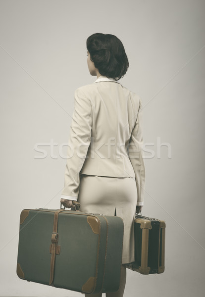 Attractive vintage woman with suitcases rear view Stock photo © stokkete