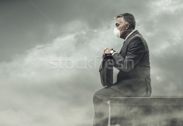 Businessman and polluted city Stock photo © stokkete