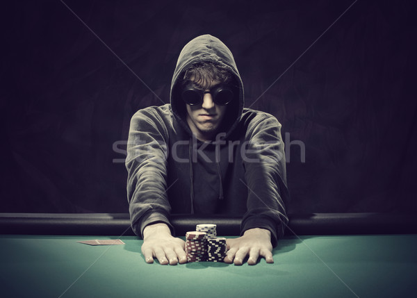 Poker player going all-in Stock photo © stokkete