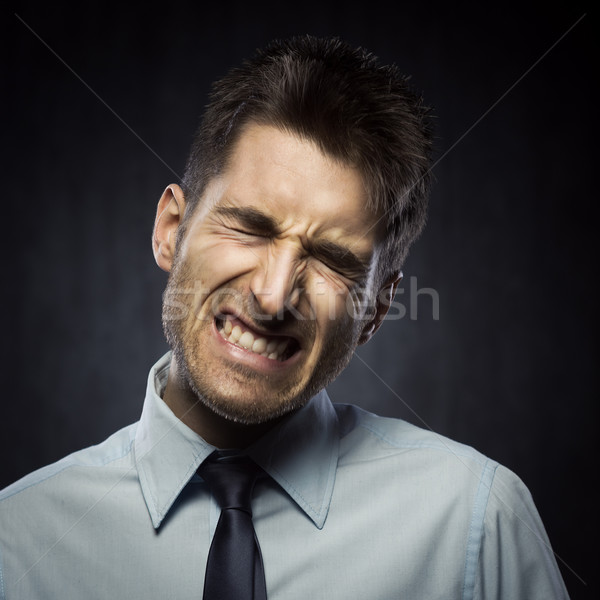 Angry young businessman Stock photo © stokkete