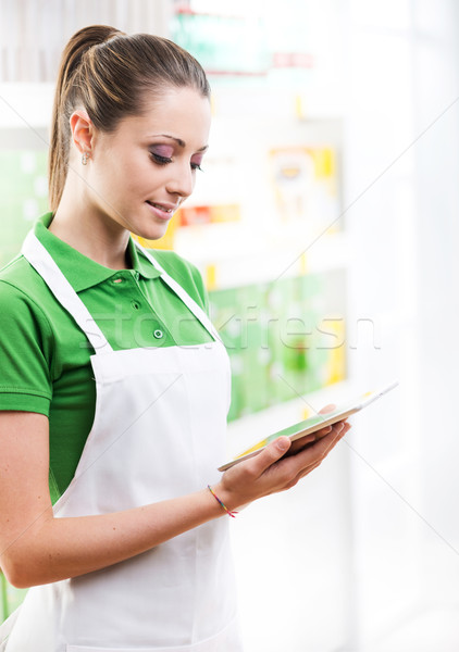 Sales clerk with tablet Stock photo © stokkete