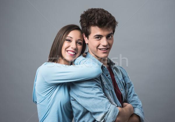 Happy young couple posing Stock photo © stokkete
