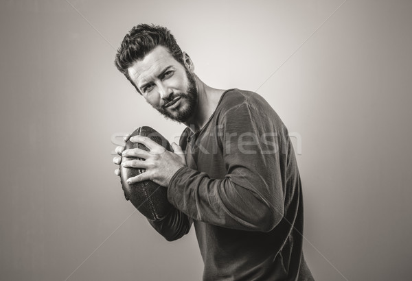 Attractive young fotball player Stock photo © stokkete