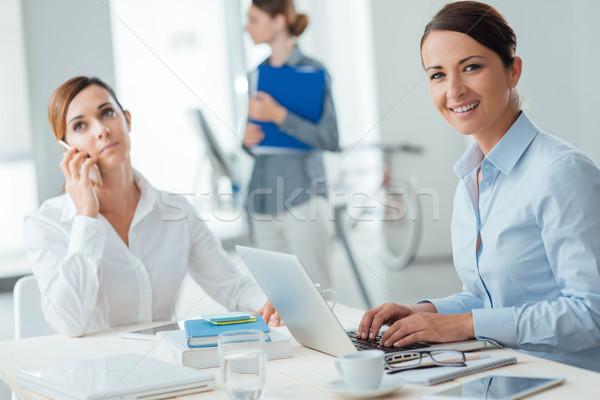 Successful women entrepreneurs at work Stock photo © stokkete