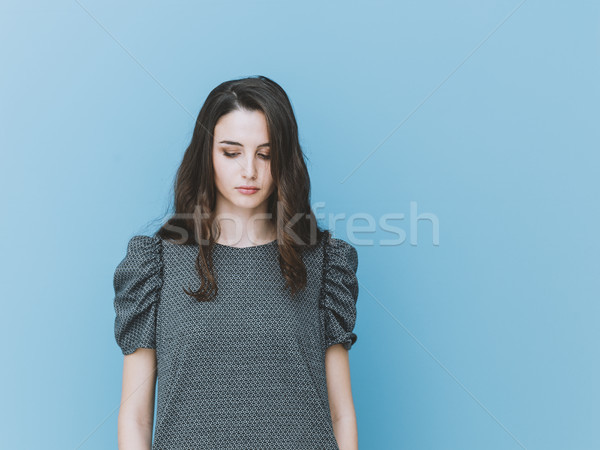Elegant girl looking down Stock photo © stokkete