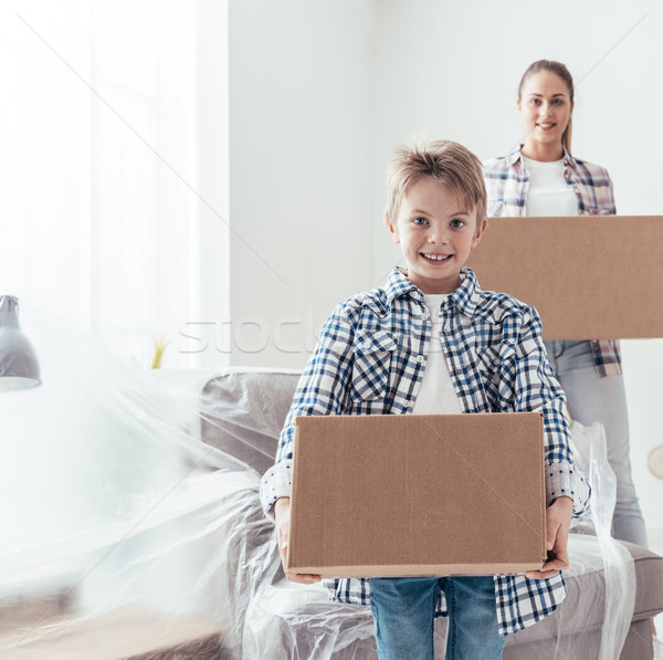 Happy family in their new home Stock photo © stokkete