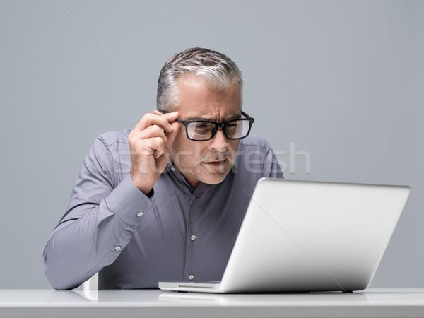 Businessman having vision problems Stock photo © stokkete