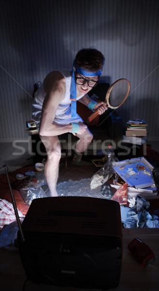 Tenis fan oglądanie telewizji młody człowiek fanatyk gry Zdjęcia stock © stokkete