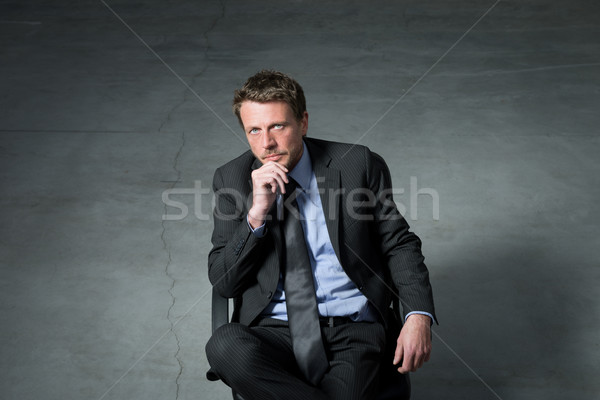 Businessman sitting on an office chair Stock photo © stokkete
