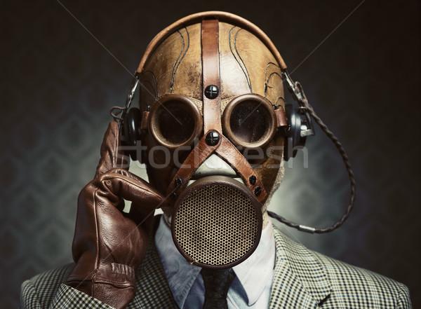 Vintage máscara de gas auriculares hombre escuchar música Foto stock © stokkete