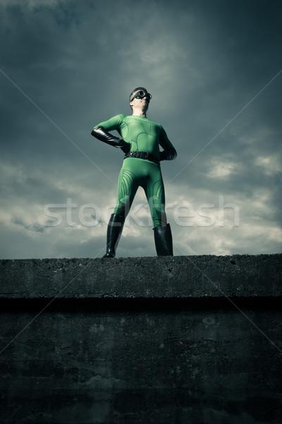 Superhero Постоянный стены зеленый облачный небе Сток-фото © stokkete