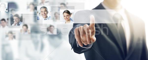 Işadamı dokunmatik ekran arayüz itme düğme insanlar Stok fotoğraf © stokkete