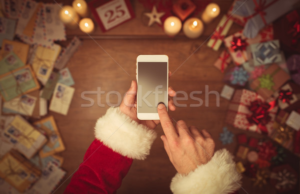 Santa Claus using a smart phone Stock photo © stokkete