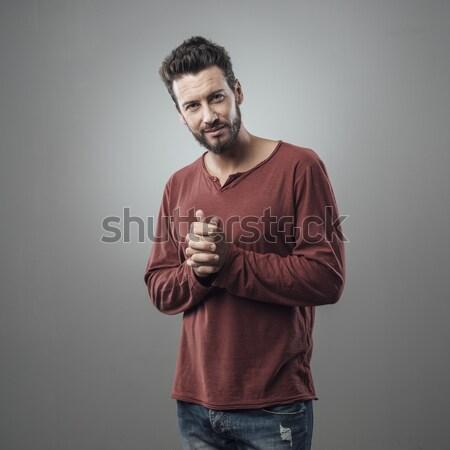Férfi pózol szürke vonzó divat portré Stock fotó © stokkete