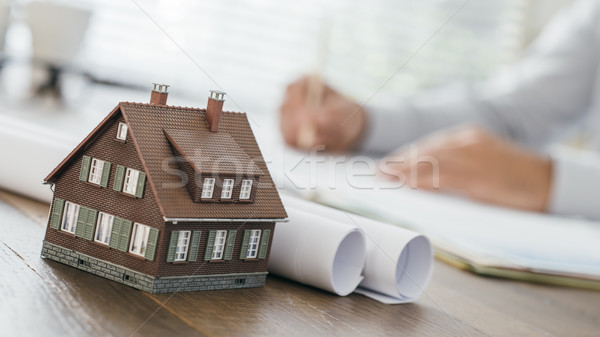 Architect working at office desk Stock photo © stokkete