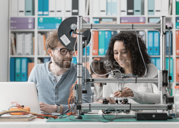 Engineering students using a 3D printer Stock photo © stokkete