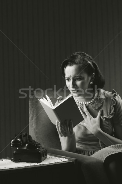 Worried woman reading a book Stock photo © stokkete