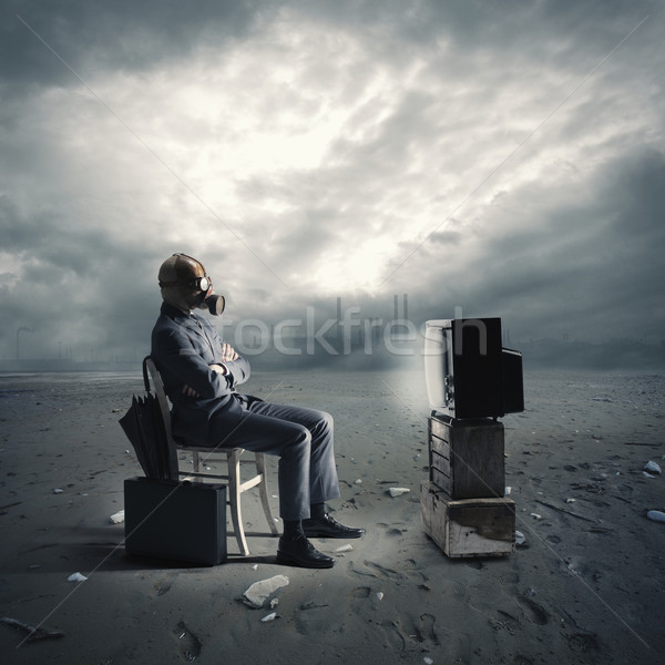 businessman with gas mask watching TV Stock photo © stokkete